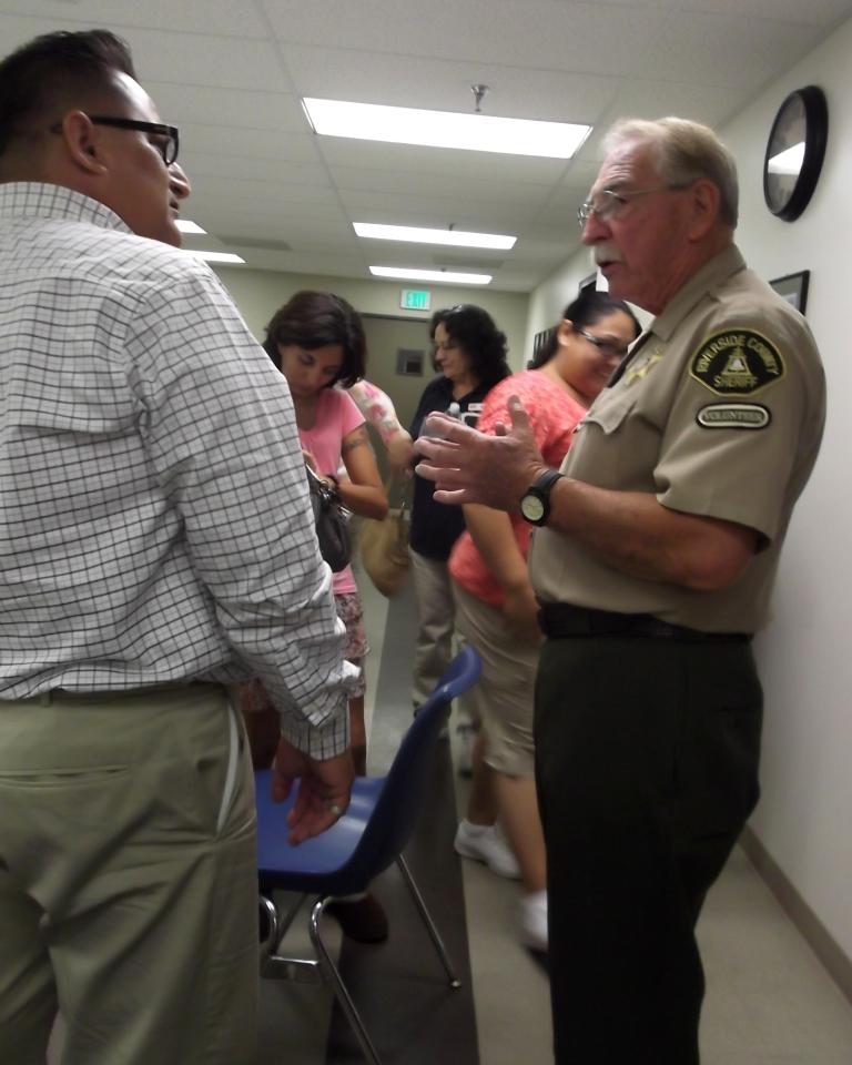 Citizen On Patrol Warrick Talks to Habitat Homeowners