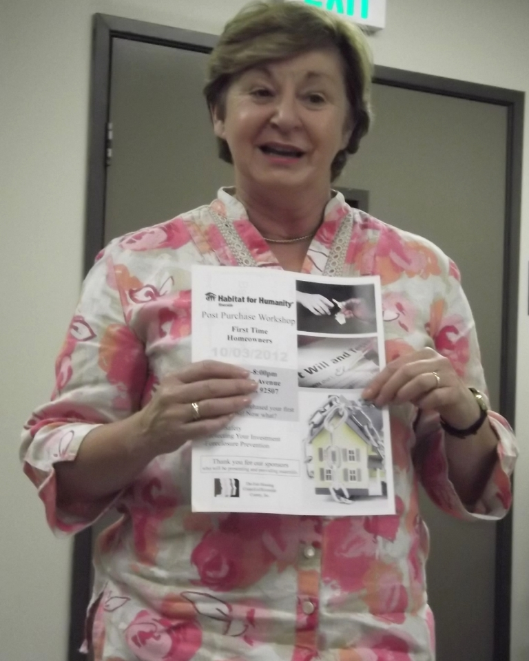 Executive Director Karin Roberts prepares families for their next Post Purchase workshop.