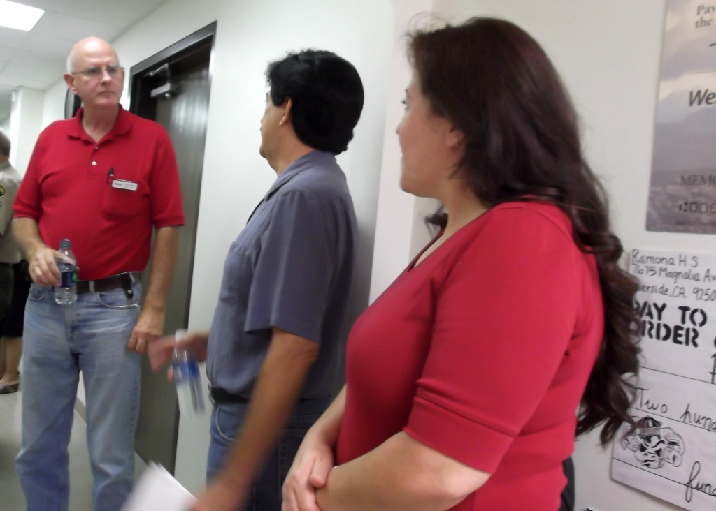 Project Manager Scott Andrews speaks to Habitat homeowners